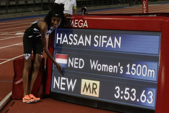 Netherlands' Sifan Hassan poses next to her time displayed on the screen after winning the women's 1500m REUTERS/Ciro De Luca