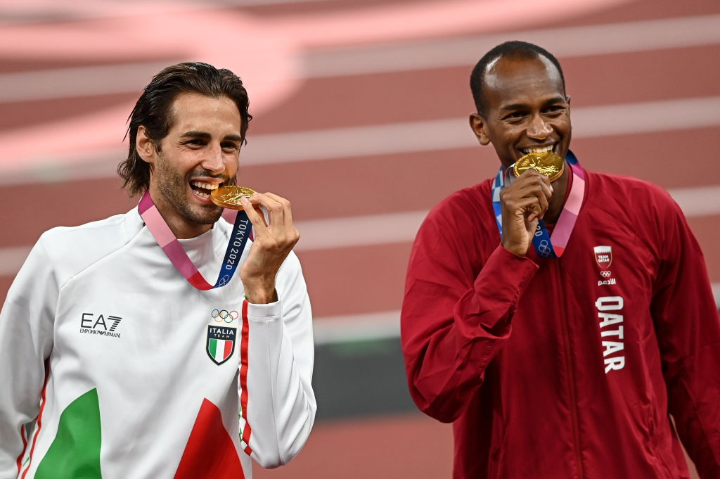 ALL GOLD: Joint gold medalists Gianmarco Tamberi of Italy, left, and Mutaz Essa Barshim of Qatar during the men's high jump victory ceremony Photo By Ramsey Cardy/Sportsfile via Getty Images