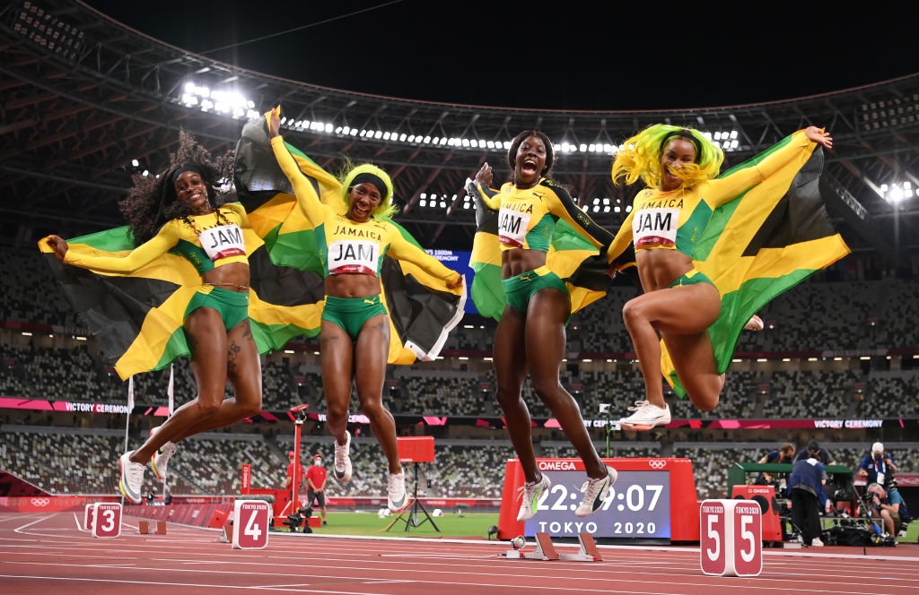 TOKYO, JAPAN - AUGUST 06: Briana Williams, Elaine Thompson-Herah, Shelly-Ann Fraser-Pryce and Shericka Jackson of Team Jamaica celebrate winning the gold medal in the Women's 4 x 100m Relay Final on day fourteen of the Tokyo 2020 Olympic Games at Olympic Stadium on August 06, 2021 in Tokyo, Japan. (Photo by Matthias Hangst/Getty Images)