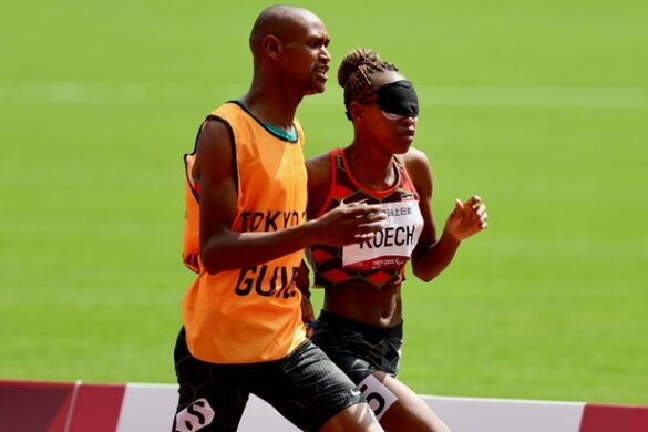 Kenya's Nancy Chelangat Koech competes in the Women's 1500m T11 final with the help of her guide Geoffrey Malel Kiplangat during the 2020 Tokyo Paralympics Games at the Tokyo Olympic Stadium on Monday, August 30, 2021. [Team Kenya Paralympics]