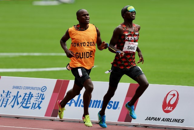 Kenya's Eric Sang competes in the Men's 1500m T11 semi-final Heat 2 with the help of his guide David Korir during the 2020 Tokyo Paralympics Games at the Tokyo Olympic Stadium on Monday, August 30, 2021. [Team Kenya Paralympics]