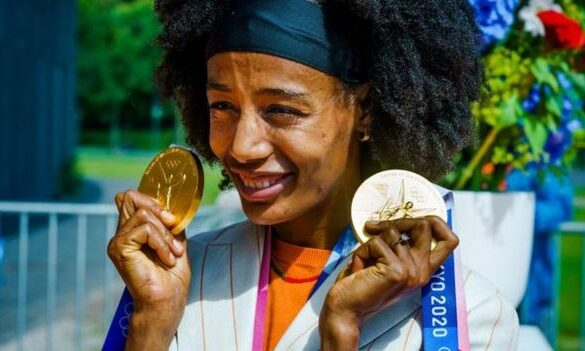 Ethiopian-born Dutch athlete Sifan Hassan with her two gold medals from the Tokyo Olympics