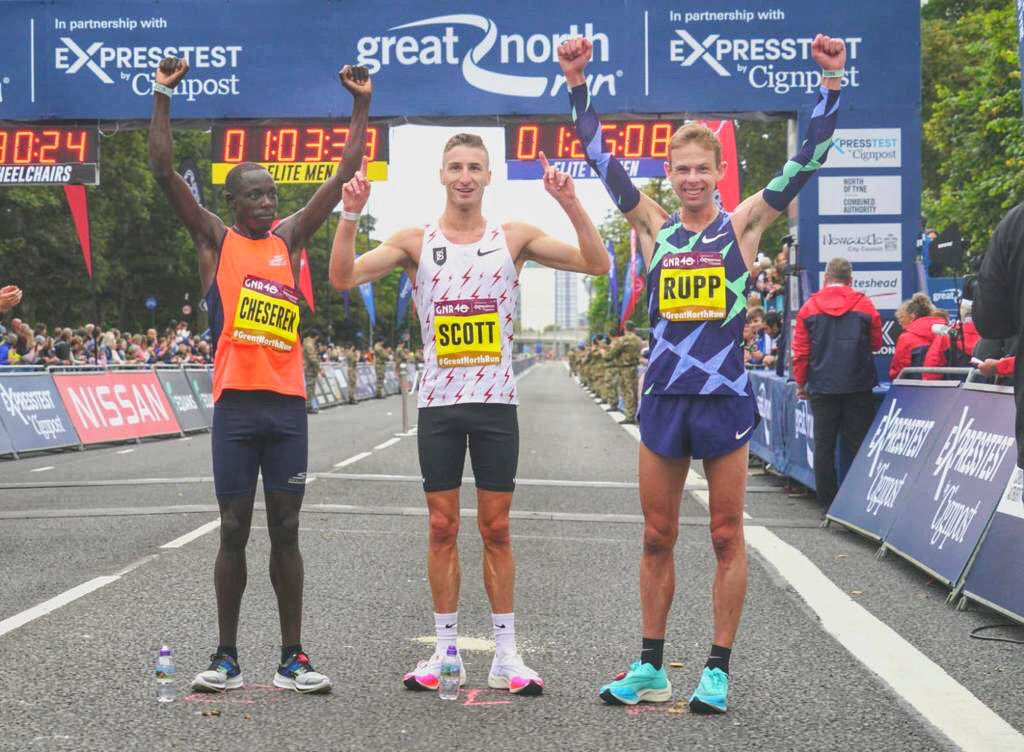 Edward Cheserek from Kenya (L) Marc Scott from Britain (c) and Galen Rupp from United States pose for a photo after the race. PHOTO: GNR