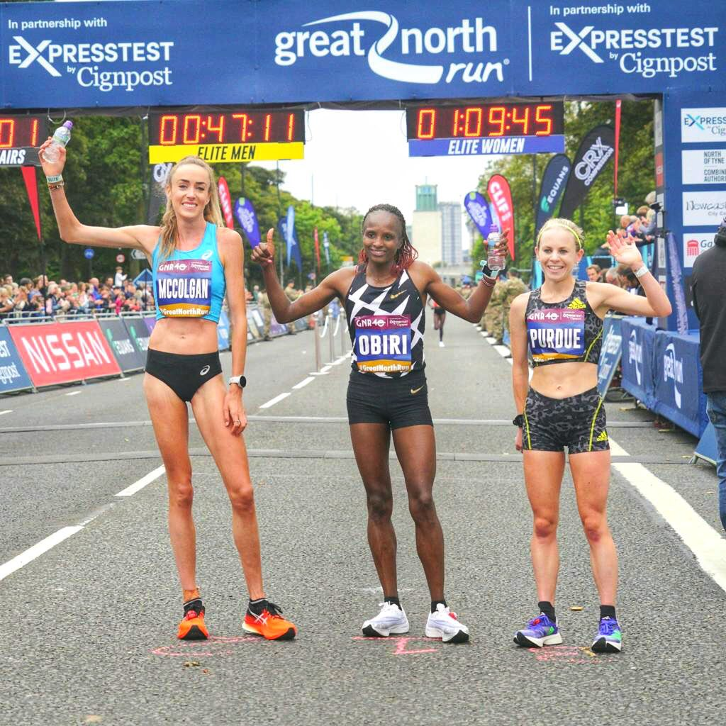 Eilish McColgan (L) Hellen Obiri (C) and Charlotte Purdue from UK pose for a photo after the race. PHOTO: GNR